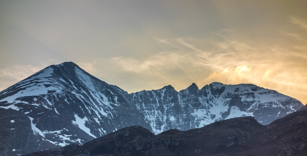 A spectacular send-off from a spectacular mountain as the sun goes down behind Coire Glas Tholl