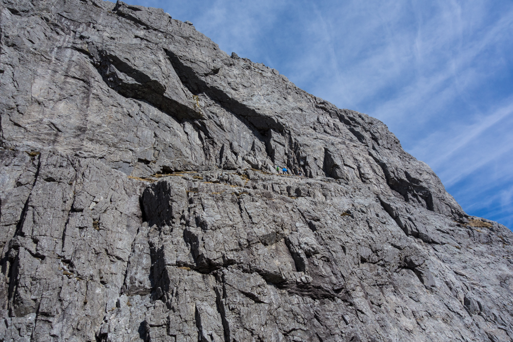 The monolithic South Wall of Garbh Bheinn with climbers just about to start up Excalibur