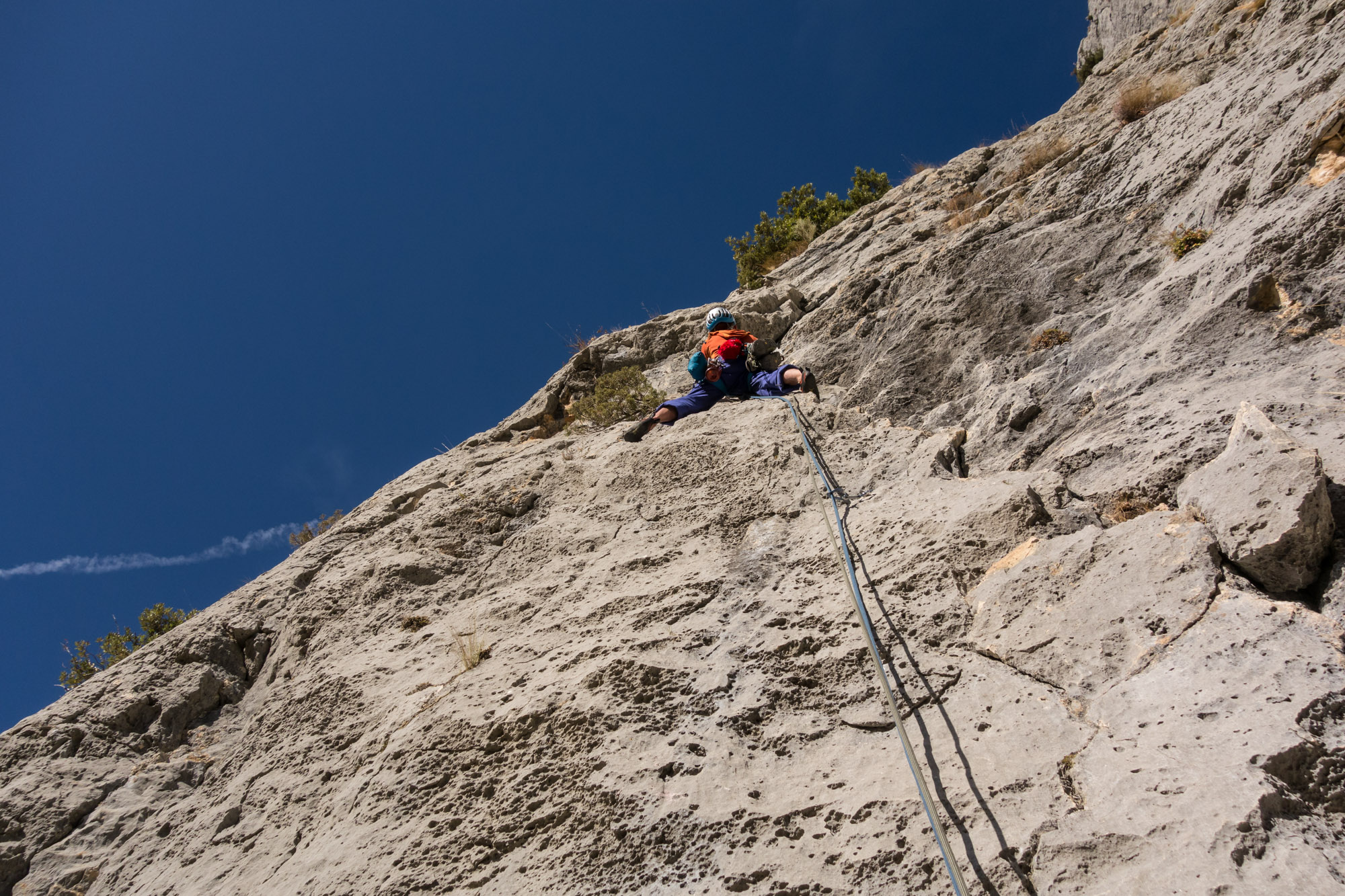 Immaculate rock, beautiful climbing and blazing sunshine - getting into the swing of things on the second pitch of Dalles Grises