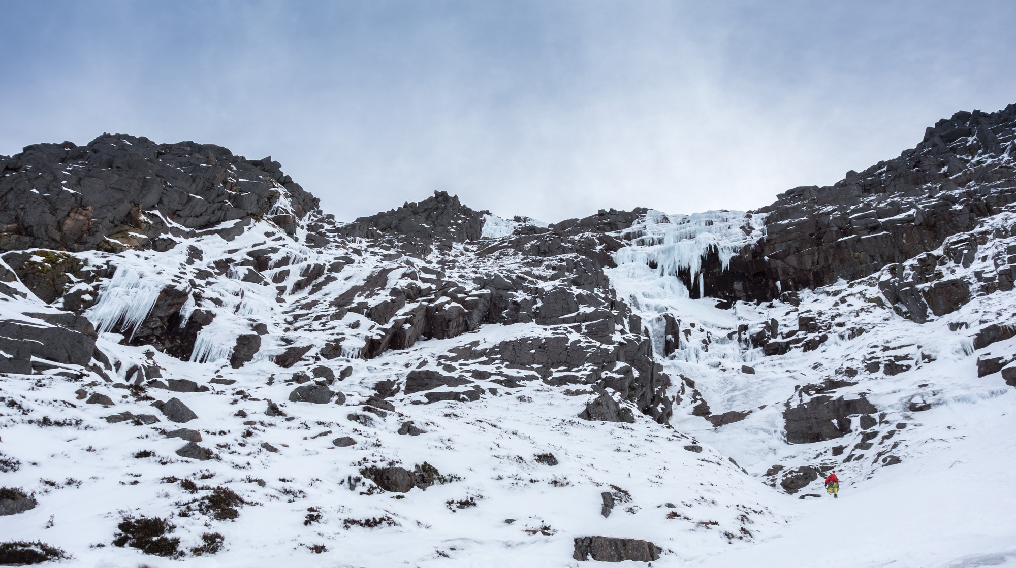 Joe approaching the start of Window Gully. The upper icefall of K9 can just be seen in the centre of the photo.