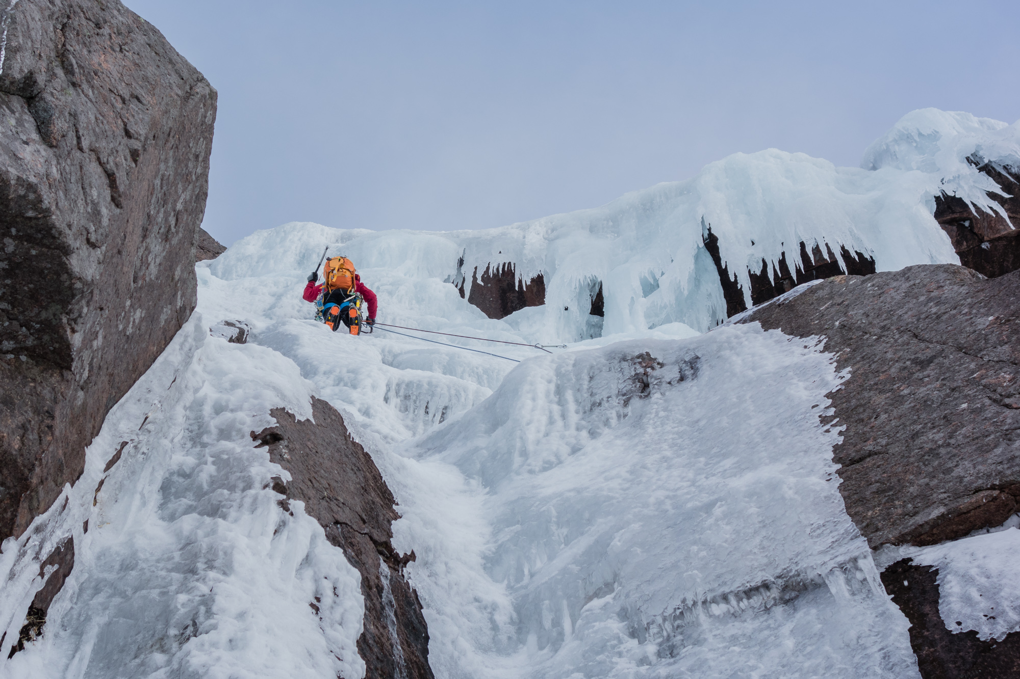 Andy approaching the final steepening after a rising traverse on slightly worrying ice. Photo credit: Joe Dobson
