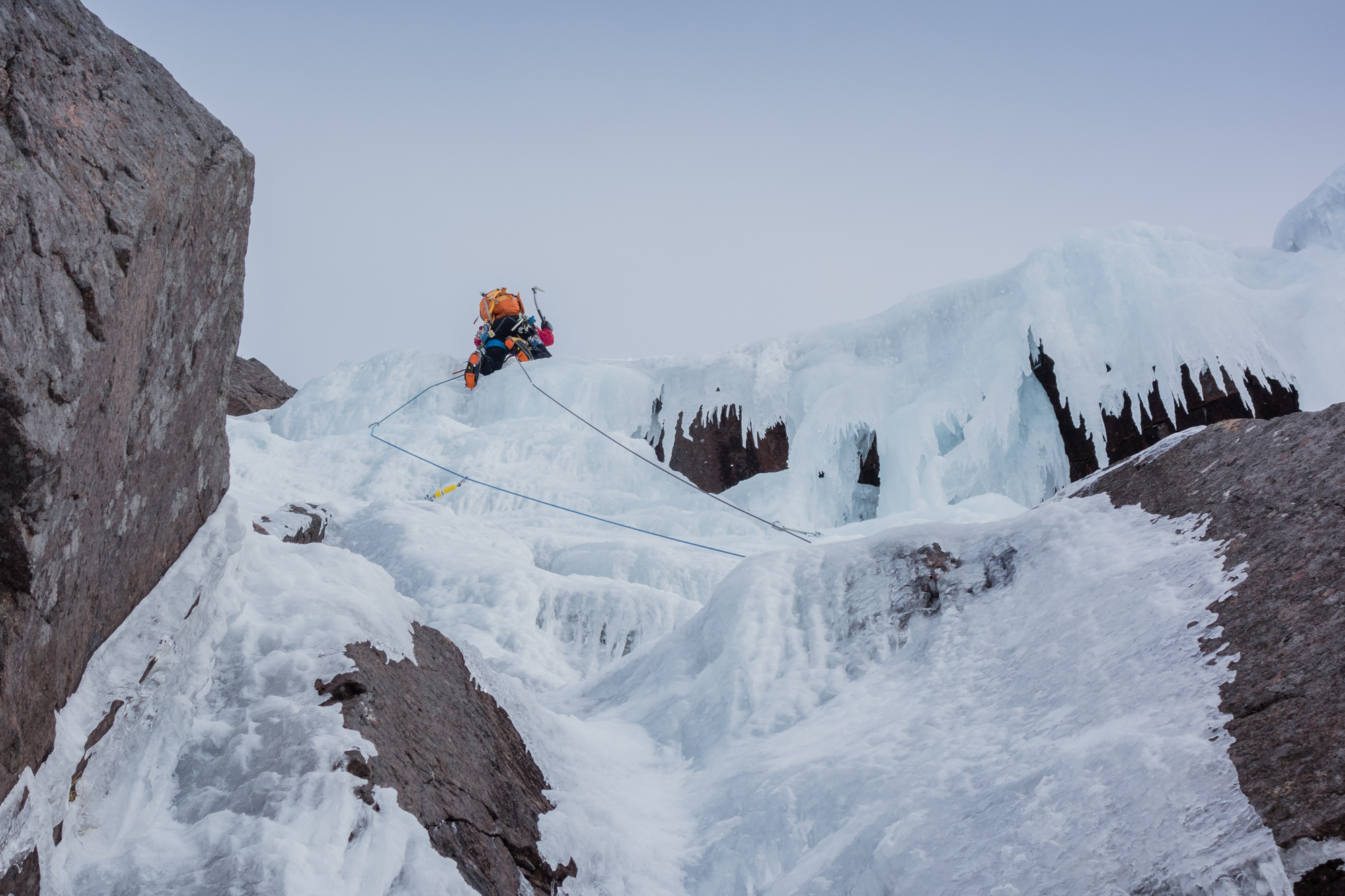 Andy pulling the final bulge on the crux second pitch - good ice where we needed it! Photo credit: Joe Dobson