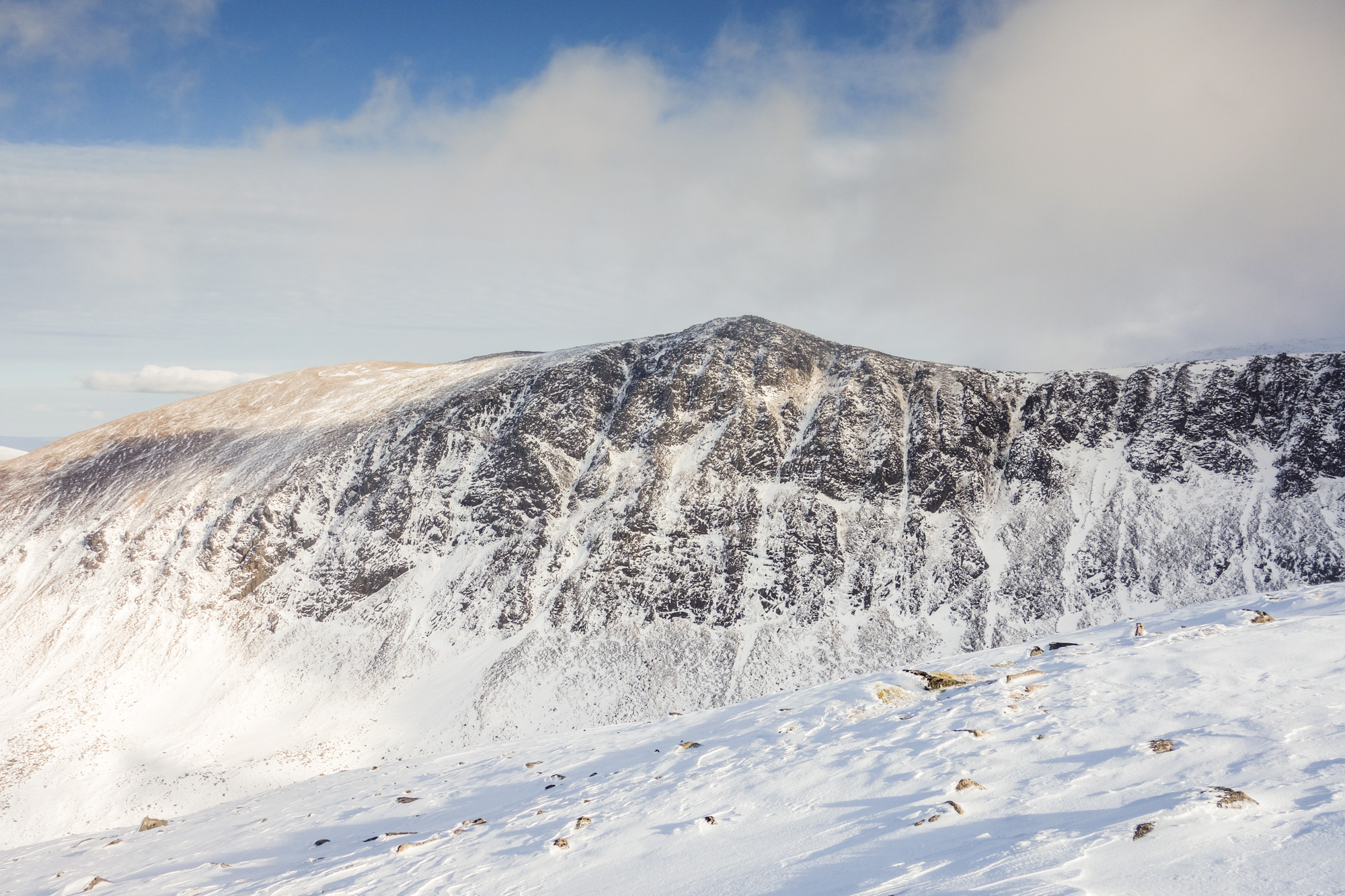 A lean and icy Lurchers Crag as seen from the approach to Braeriach. Window Guly is the wide ice streak left of the obvious Central Gully. Photo credit: Andy Inglis