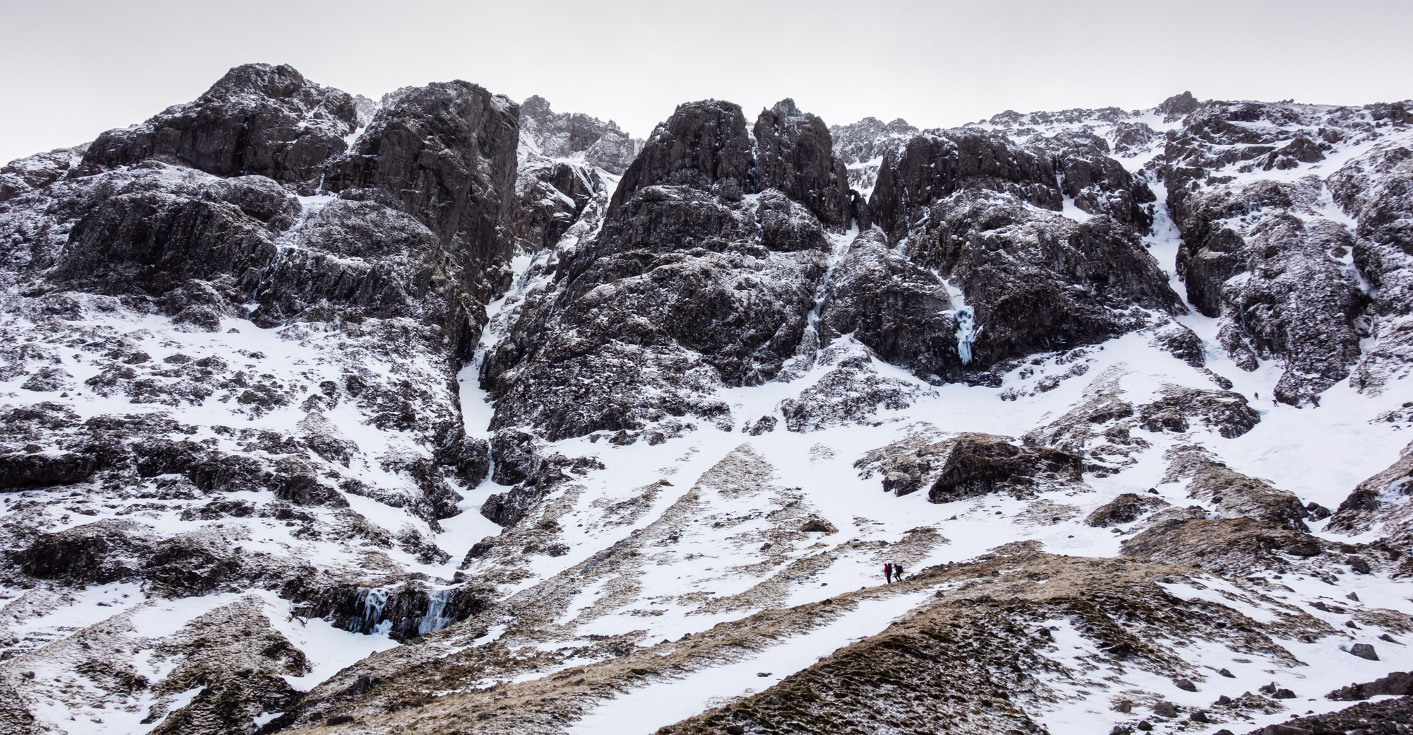 The complex West Face of Aonach Dubh with the obvious rift of No4 Gully centre-left and No6 Gully on the far right