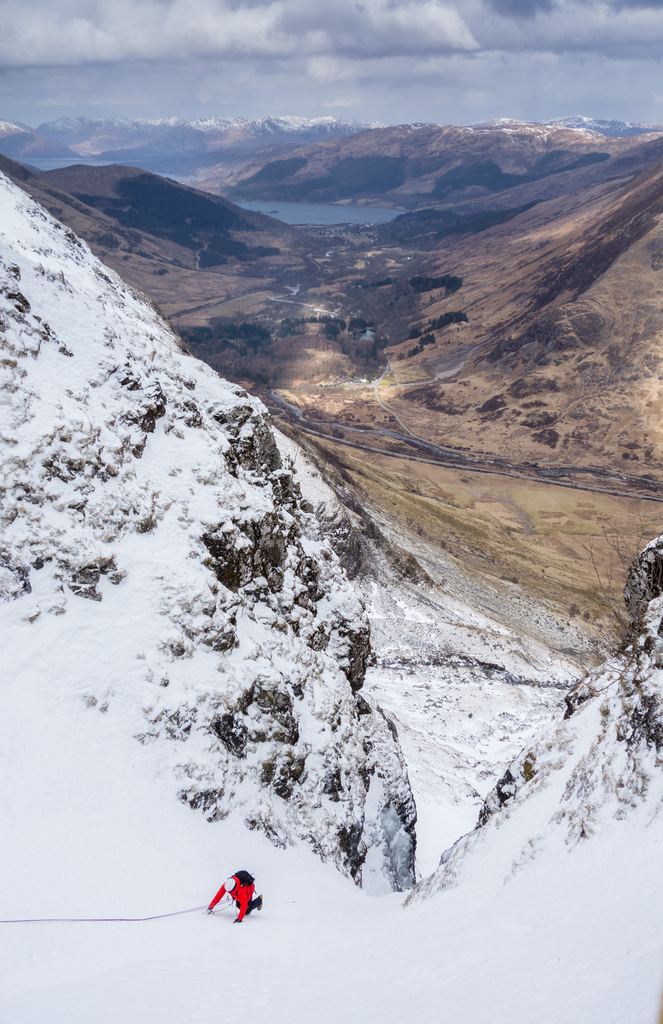 The team behind us finishing the second pitch with amazing views to Loch Leven and beyond. Photo credit: Ric Hines