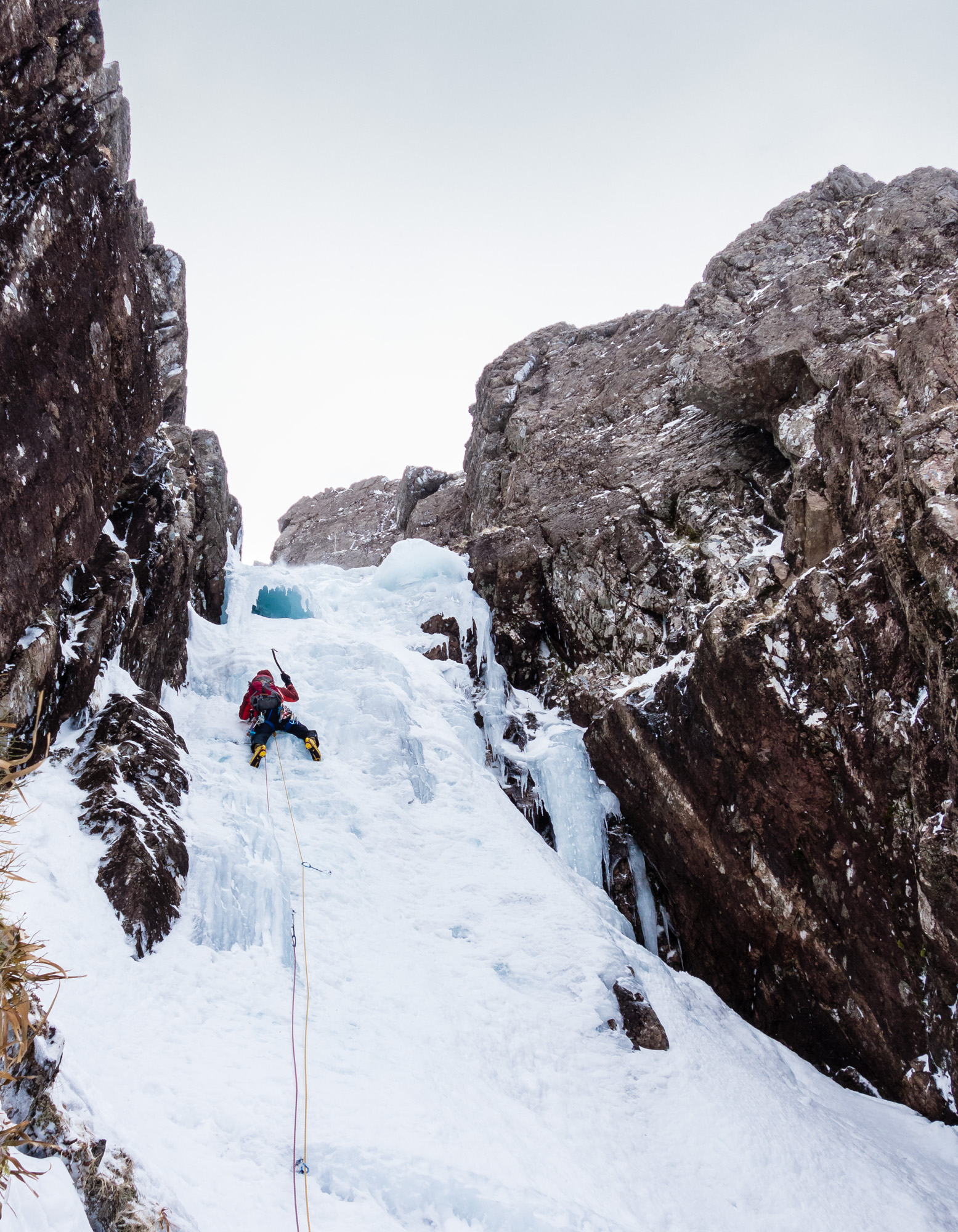 The crux pitch was stepped out but interest was maintained by the variable ice quality and the need to pull funky shapes to bypass the ice umbrella at the top. Photo credit: Ric Hines