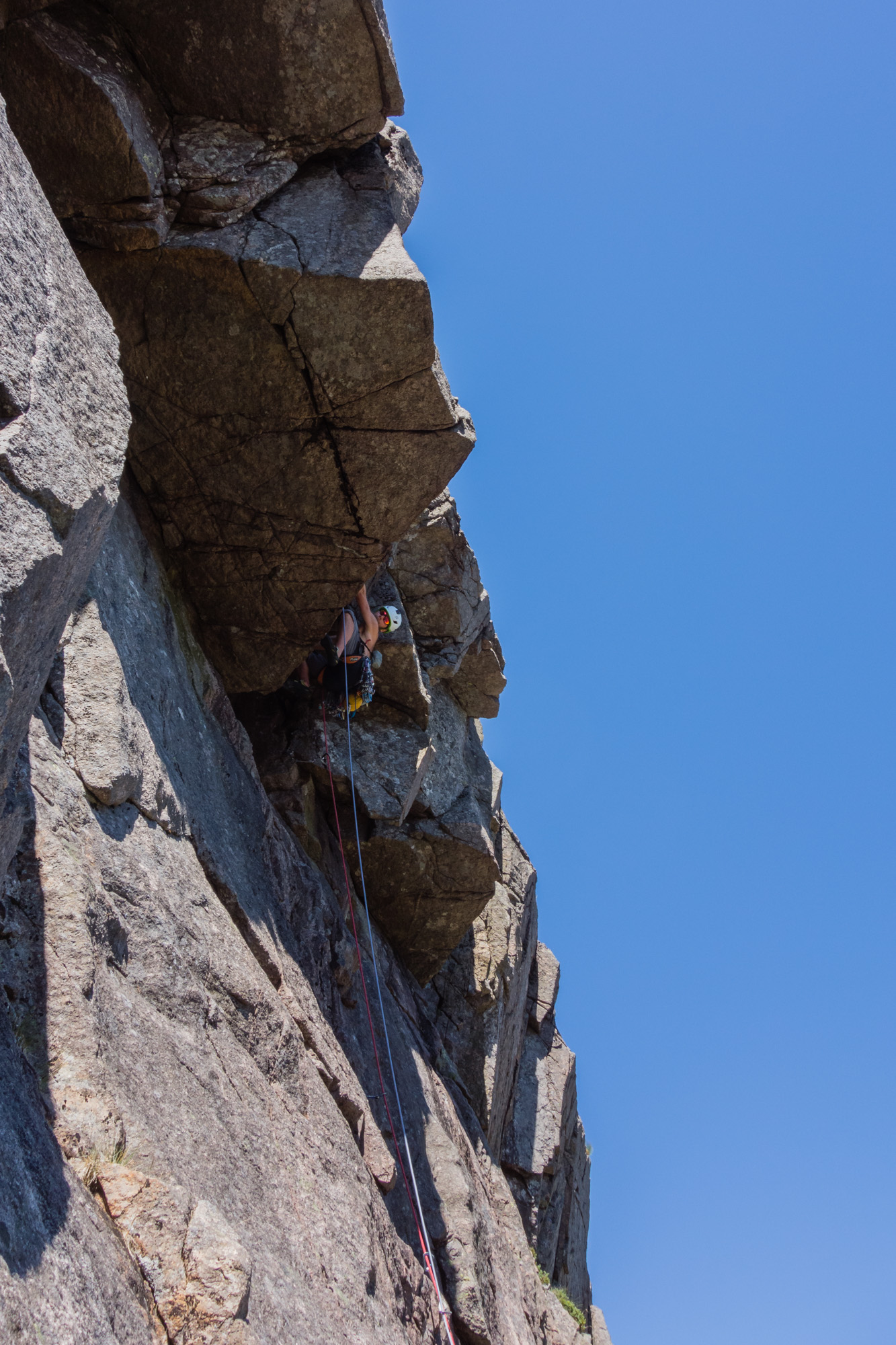 Callum moving smoothly through the steepness. An old peg provides the protection until a little more height is gained