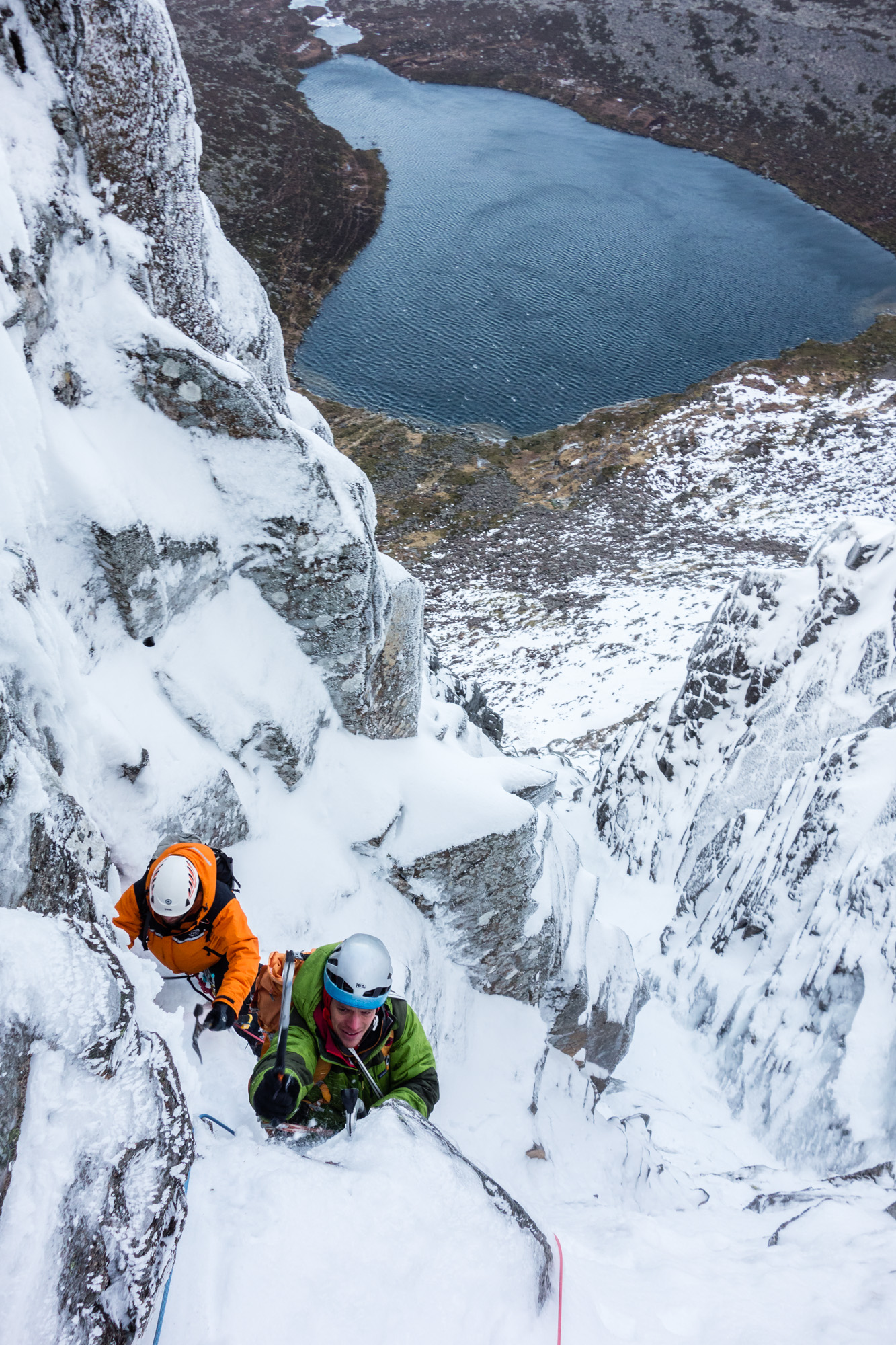 The top of the difficulties on pitch 5, where an exposed move left around the projecting block gains the easier angled gully above